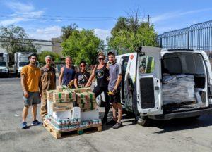 Happy vegans loading donations